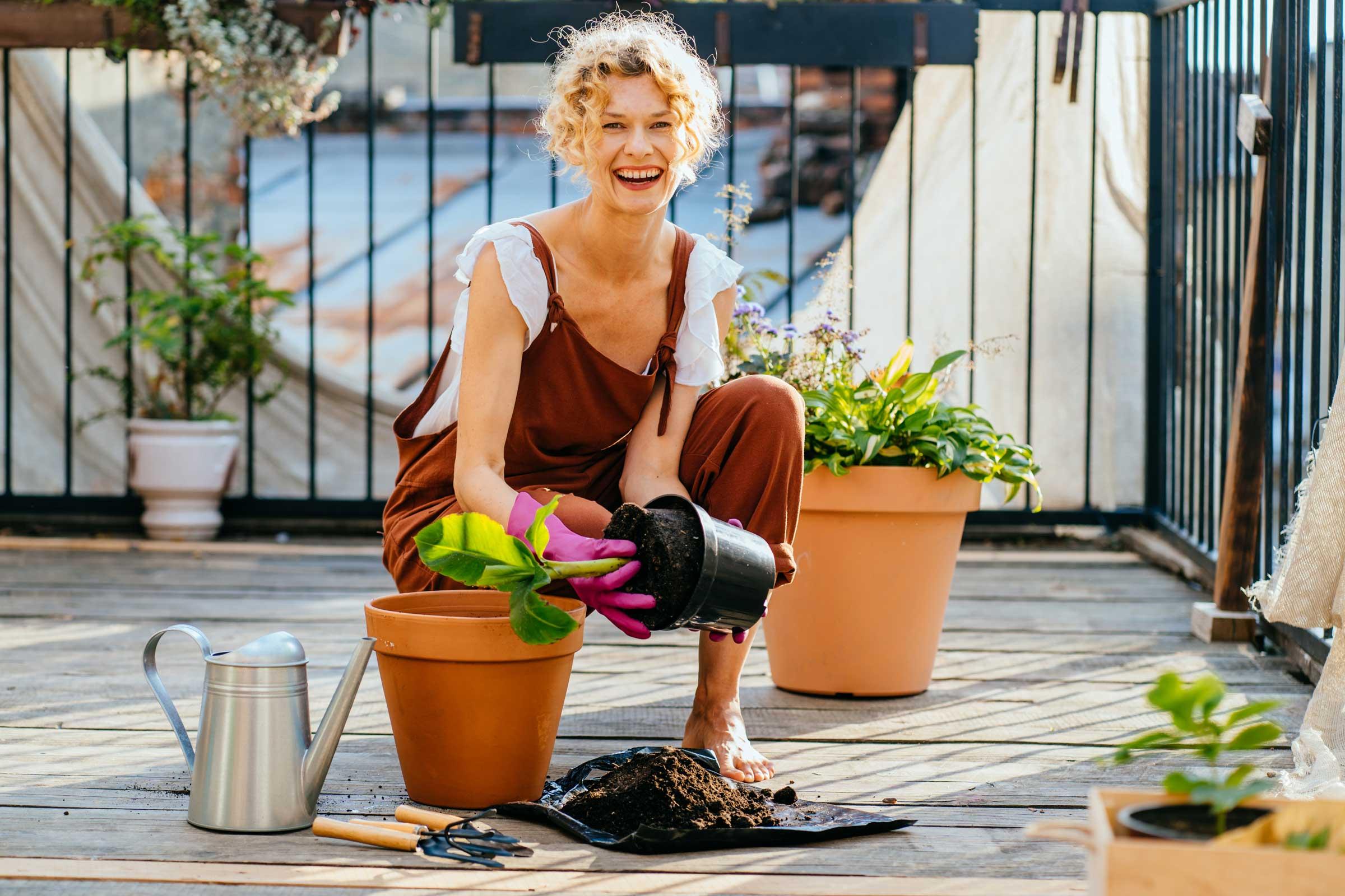 Woman on deck gardening